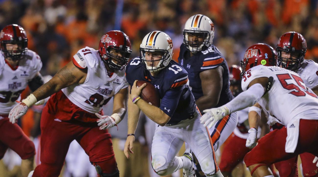 Auburn quarterback Sean White (13) scrambles for yardage against Arkansas State during the second half of an NCAA college football game, Saturday, Sept. 10, 2016, in Auburn, Ala. Auburn won 51-14 (AP Photo/Butch Dill)