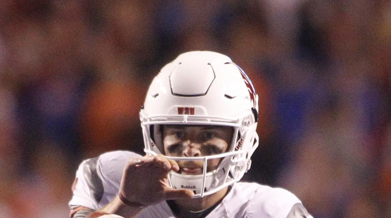 Washington State quarterback Luke Falk (4) takes the snap during the second half of an NCAA college football game against Boise State in Boise, Idaho, on Saturday, Sept. 10, 2016. (AP Photo/Otto Kitsinger)