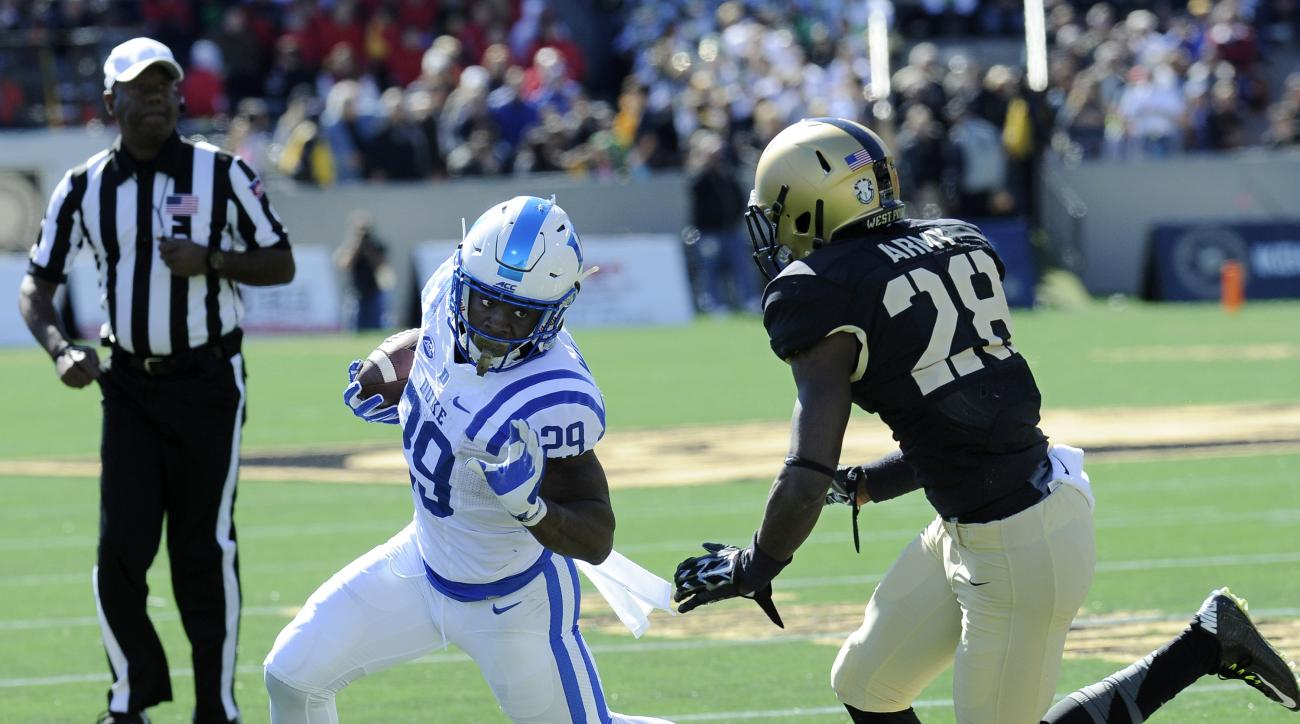 Duke running back Shaun Wilson (29) runs the ball while being defended by Army cornerback Brandon Jackson (28) during the first half of an NCAA college football game on Saturday, Oct. 10, 2015, in West Point, N.Y. Duke won the game 44-3. (AP Photo/Hans Pe