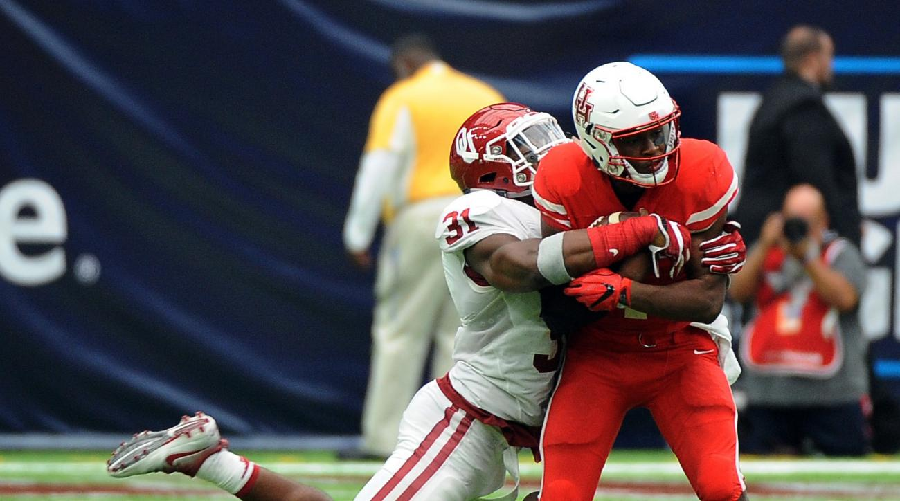 FILE - In this Sept. 3, 2016, file photo, Houston quarterback Greg Ward Jr. (1) is tackled by Oklahoma linebacker Ogbonnia Okoronkwo (31) in the second half of Houston's 33-23 victory in an NCAA college football game, in Houston. There's good news and bad