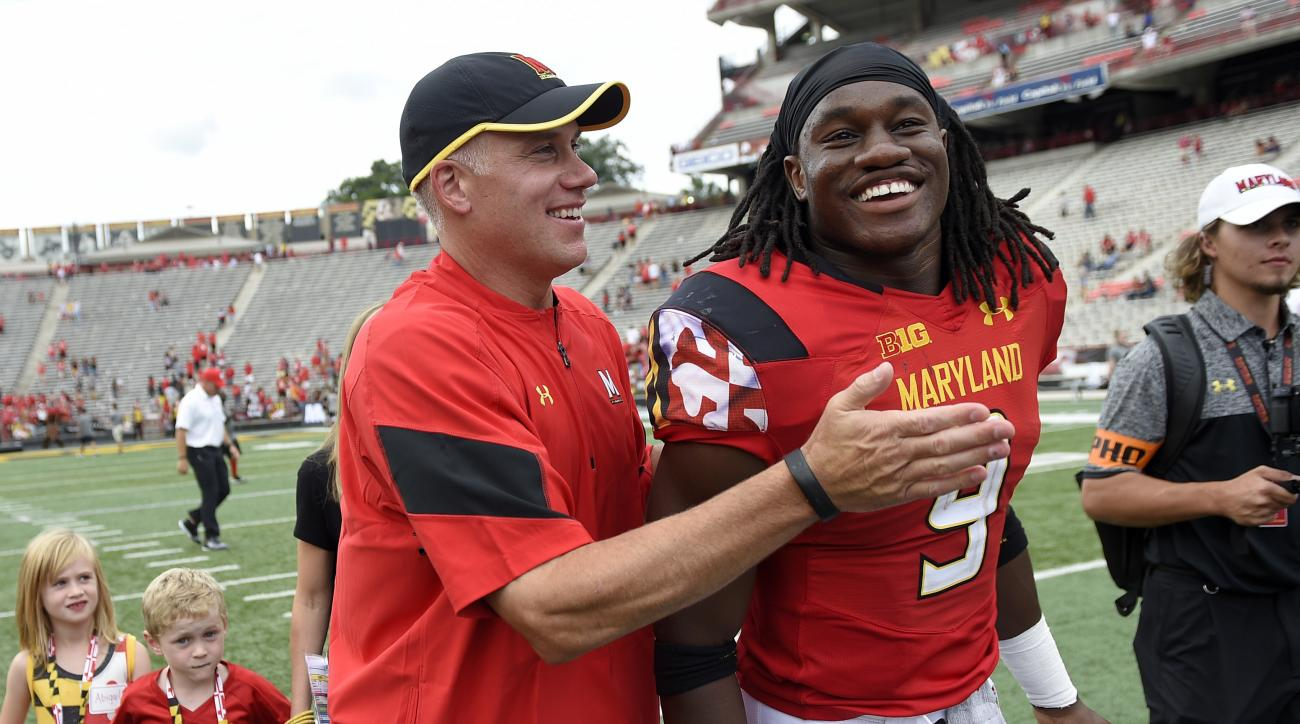 FILE - In this Sept. 3, 2016, file photo, Maryland head coach DJ Durkin, left, reacts with running back Trey Edmunds (9) as the walk off after an NCAA football game against Howard, in College Park, Md. Maryland has learned how to beat other teams instead