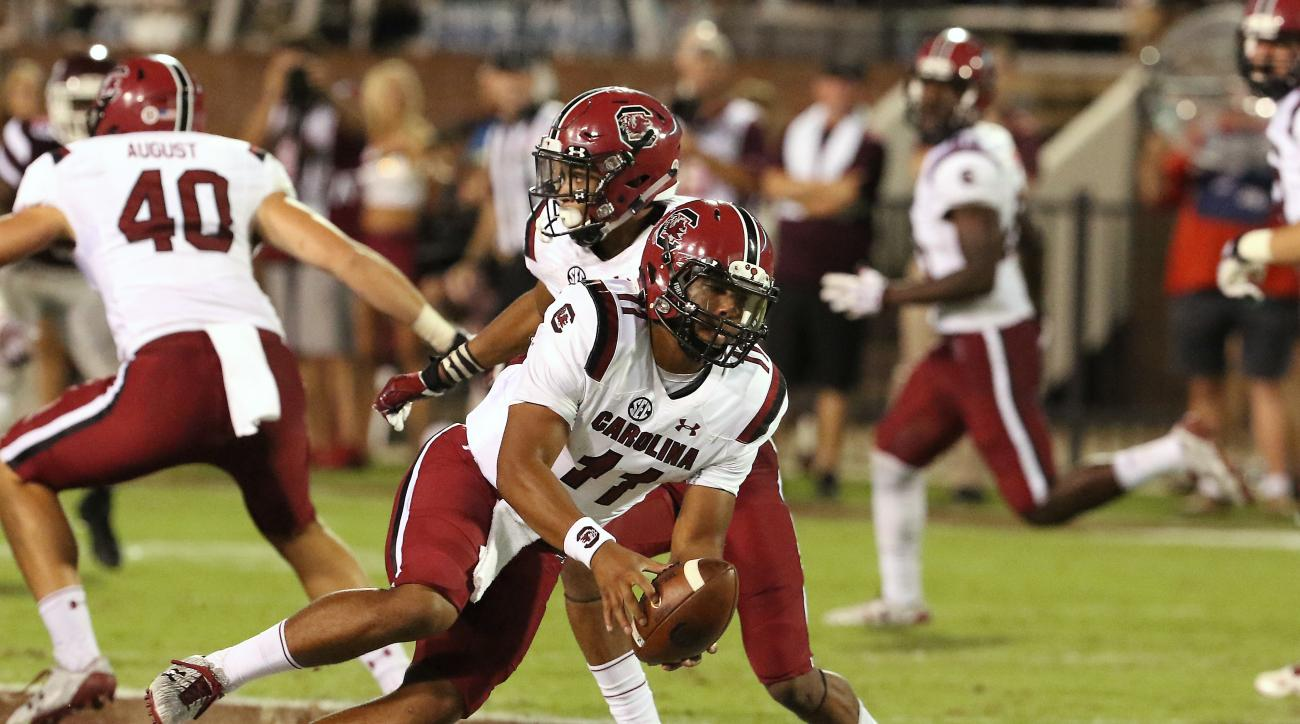 FILE - In this Sept. 10, 2016, file photo, South Carolina quarterback Brandon McIlwain (11) picks up the ball after it was snapped over his head during the second half of an NCAA college football game against Mississippi State in Starkville, Miss. Mississ