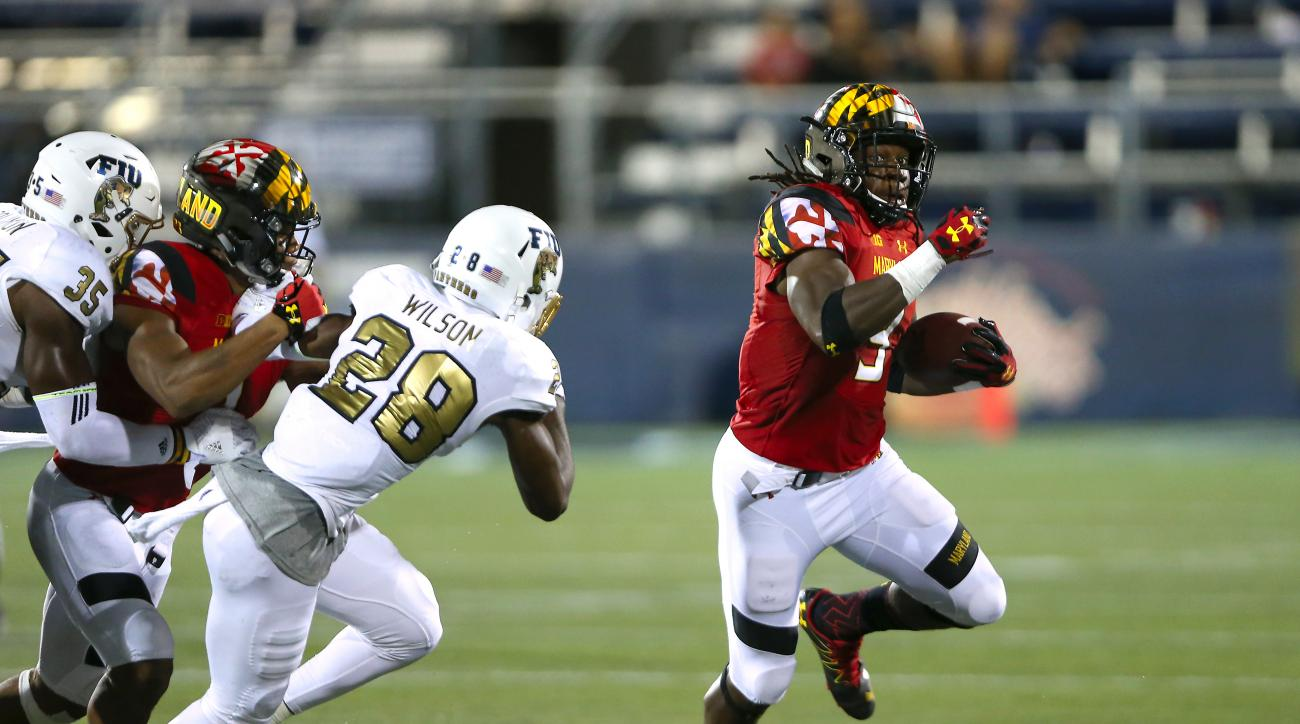 FILE - In this Sept. 9, 2016, file photo, Maryland running back Trey Edmunds (9) carries the ball against Florida International safety Deonte Wilson during the second half of an NCAA college football game in Miami. Maryland has learned how to beat other t