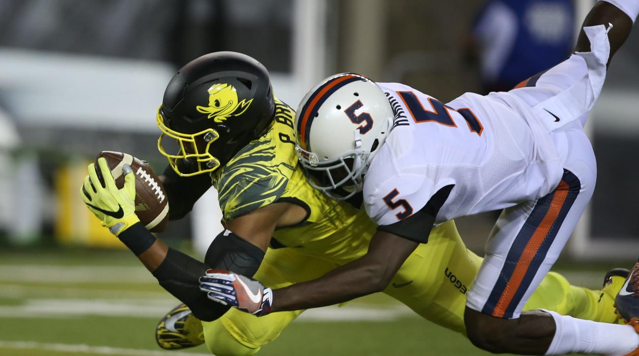FILE- In this Saturday, Sept. 10, 2016, file photo, Oregon's Pharaoh Brown, left, is brought down by Virginia's Tim Harris after a pass receptions in the first quarter of an NCAA college football game in Eugene, Ore. Brown would rather look to the future