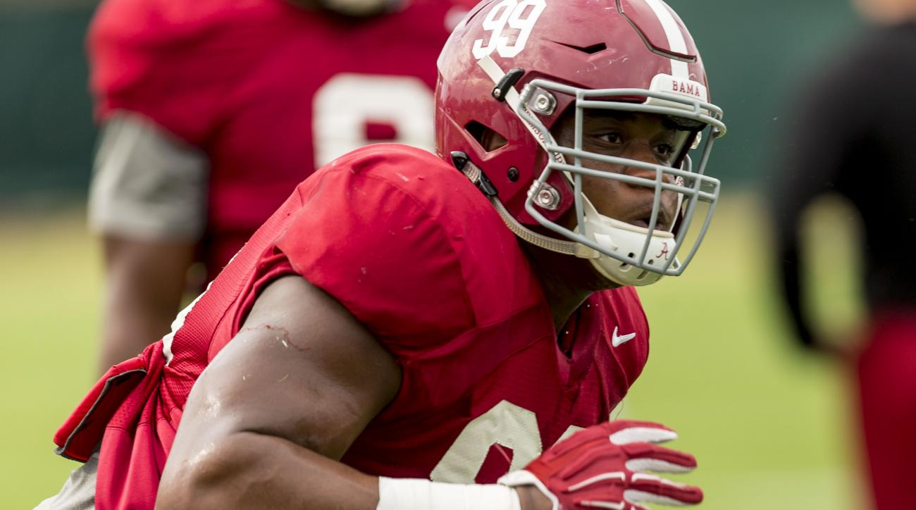 Alabama defensive lineman Raekwon Davis (99) works through drills during NCAA college football practice, Tuesday, Sept. 13, 2016, at the Thomas-Drew Practice Fields in Tuscaloosa, Ala. (Vasha Hunt/AL.com via AP)