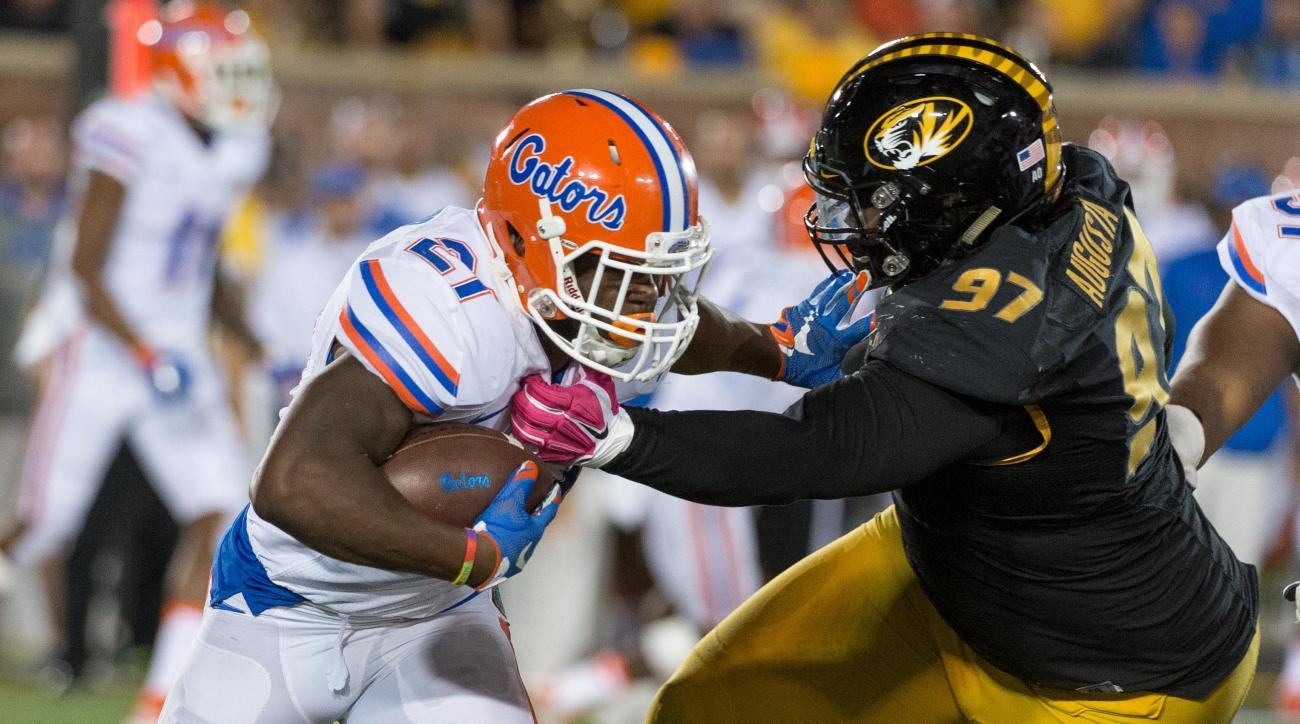 FILE - In this Oct. 10, 2015, file photo, Florida running back Kelvin Taylor, left, is wrapped up by Missouri's Josh Augusta during an NCAA college football game in Columbia, Mo. Augusta stands 6-foot-4 and weighs upward of 350 pounds. His teammates nickn