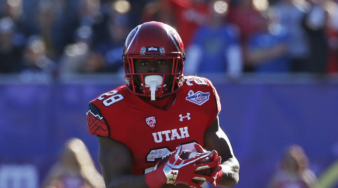 Utah running back Joe Williams (28) runs for a gain against BYU during the first half of the Las Vegas Bowl NCAA college football game Saturday, Dec. 19, 2015, in Las Vegas. (AP Photo/John Locher)