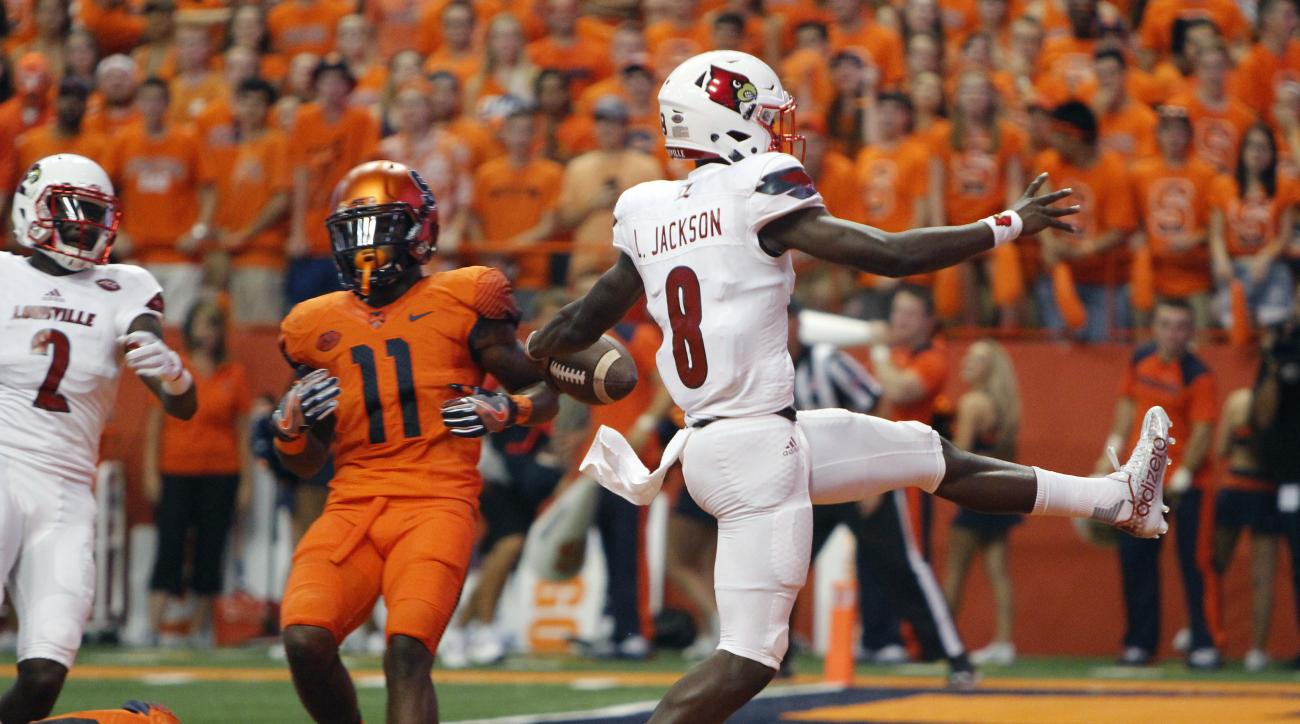 FILE - In this Sept. 9, 2016, file photo, Louisville's Lamar Jackson high-steps into the end zone for a touchdown during an NCAA college football game against Syracuse in Syracuse, N.Y. Louisville faces Florida State this week. In two games, Jackson has t