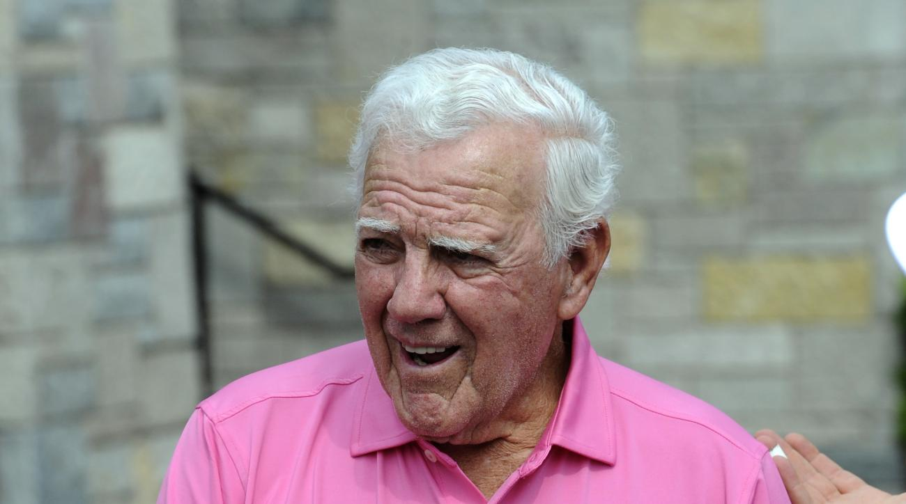 FILE - In this June 12, 2013, file photo, former Notre Dame football coach Ara Parseghian talks with golfers at the Legends golf outing in Bridgman, Mich. Parseghian still bristles 50 years later at the notion No. 1 Notre Dame played for a tie against No.