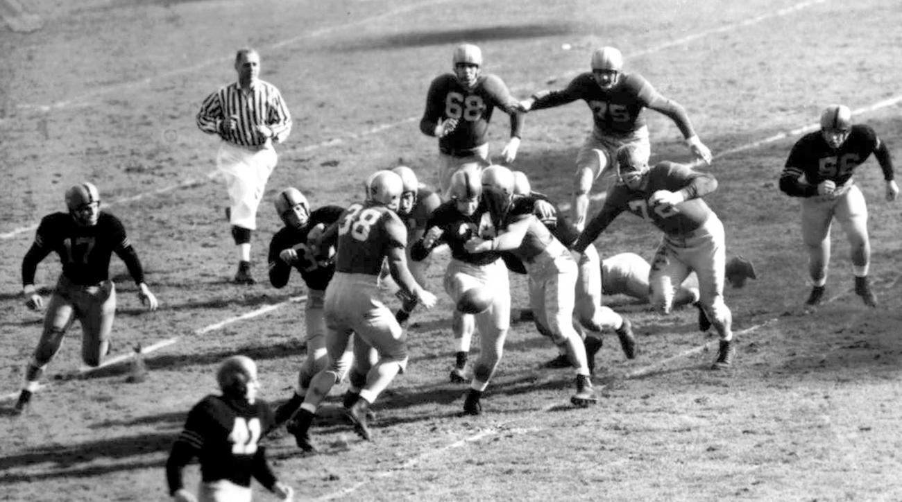 """FILE - In this Nov. 9, 1946, file photo, Army fullback Felix """"Doc"""" Blanchard (35), center left in front of the official, fumbles the ball, in air at center, during the first half against Notre Dame, at Yankee Stadium in New York. Teammate Glen Davis (41),"""
