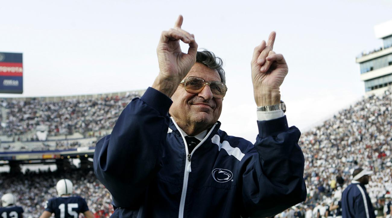 FILE - In this Nov. 5, 2005, file photo, Penn State football coach Joe Paterno acknowledges the crowd during warm-ups before an NCAA college football game against Wisconsin in State College, Pa. As Penn State's athletic department finalizes details for ho