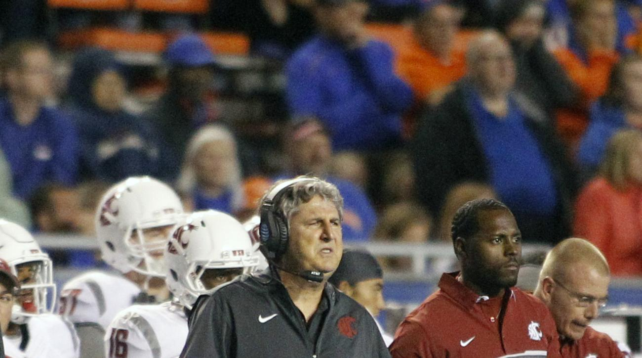 FILE - In this Saturday, Sept. 10, 2016, file photo, Washington State head coach Mike Leach reacts during the second half of an NCAA college football game against Boise State in Boise, Idaho. On Thursday, Sept. 15, 2016, WSU's president and athletic direc