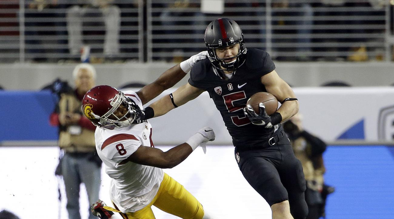 FILE - In this Dec. 6, 2015, file photo, Stanford running back Christian McCaffrey (5) stiff-arms Southern California's Iman Marshall on a kickoff return during the Pac-12 Conference championship NCAA college football game in Santa Clara, Calif. Stanford