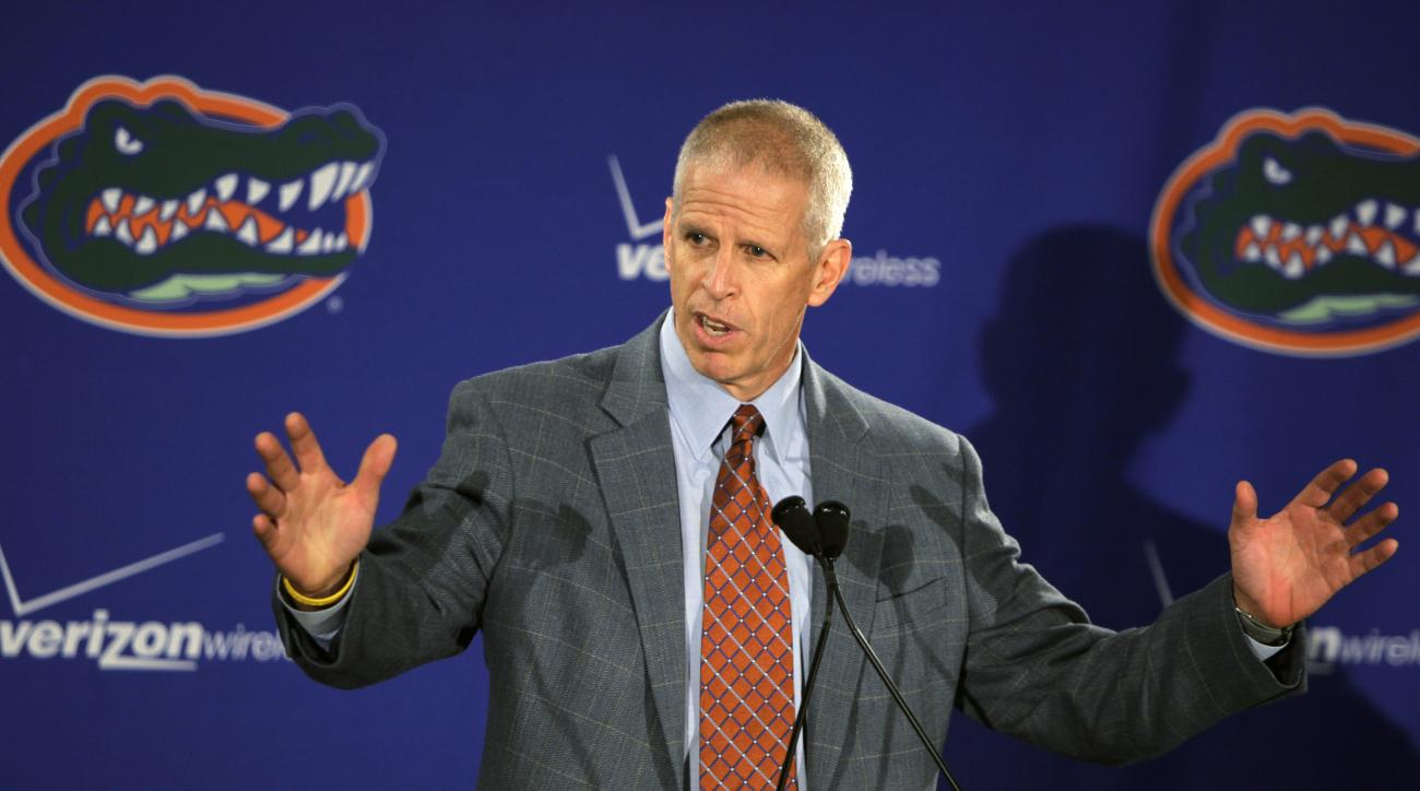 FILE - In this Dec. 8, 2010 file photo, Florida athletic director Jeremy Foley speaks to reporters after football coach Urban Meyer talks about his resignation during a news conference in Gainesville, Fla. Florida is making a strong push to catch up in th