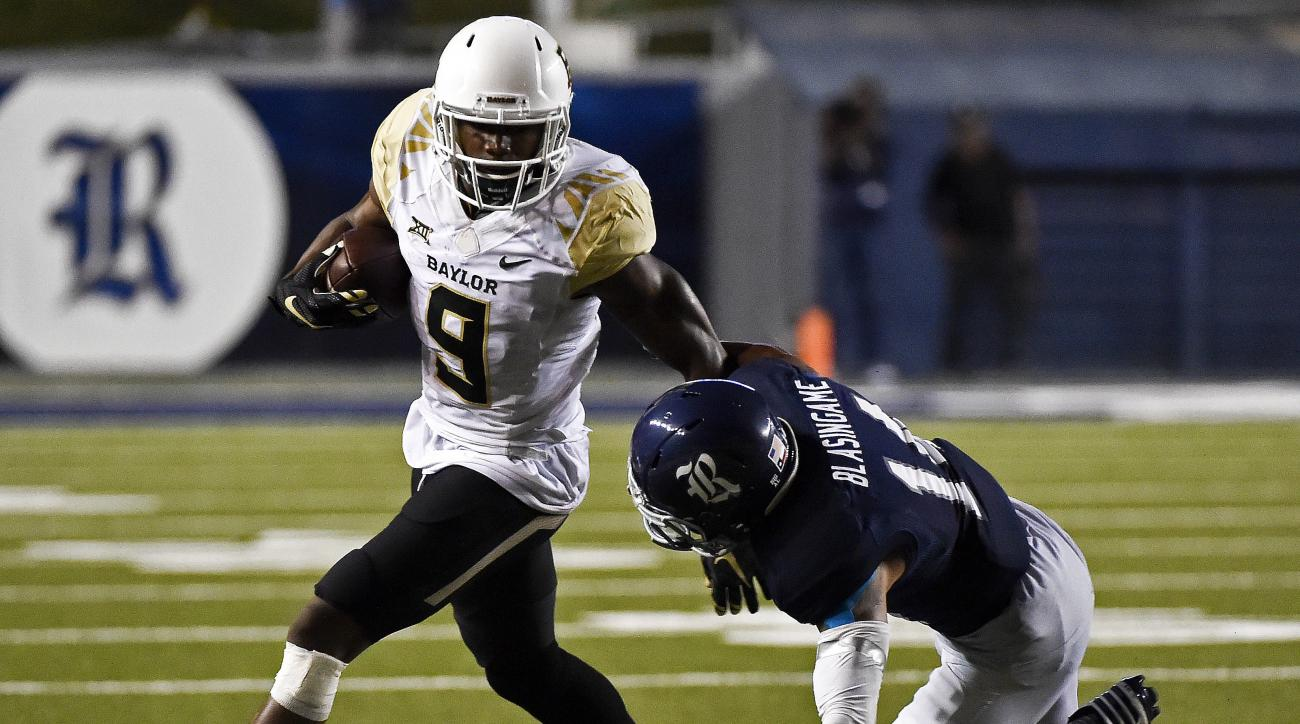 Baylor wide receiver KD Cannon (9) fends off the tackle of Rice cornerback J.T. Blasingame in the second half of an NCAA college football game, Friday, Sept. 16, 2016, in Houston. (AP Photo/Eric Christian Smith)