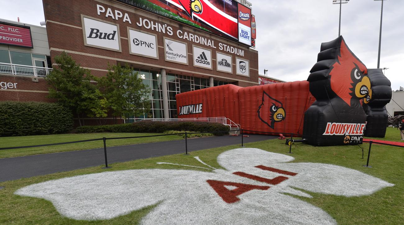 """A 30 foot white butterfly logo with """"ALI"""" in the middle located at the north end zone outside the Howard Schnellenberger football complex at Papa John' Cardinal Stadium lies in rememberance of the late champ, Saturday, Sep. 17, 2016 in Louisville Ky. Ali,"""