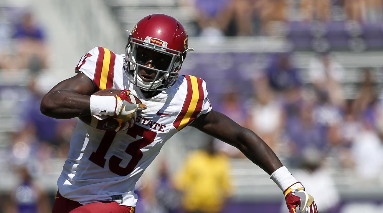 Iowa State wide receiver Dondre Daley (13) breaks free from a tackle by TCU defensive back Deante Gray (20) in the first half half of an NCAA college football game, Saturday, Sept. 17, 2016, in Fort Worth, Texas. (AP Photo/Brad Loper)