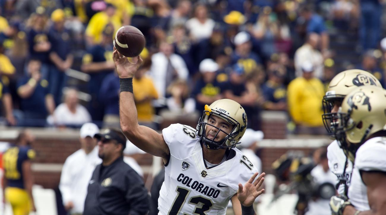 Colorado quarterback Sefo Liufau throws a pass during warmups before an NCAA college football game against Michigan at Michigan Stadium in Ann Arbor, Mich., Saturday, Sept. 17, 2016. (AP Photo/Tony Ding)