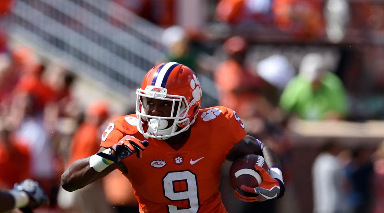 Clemson's Wayne Gallman slips through the tackle attempt of South Carolina State's Tyrell Goodwin during the first half of an NCAA college football game Saturday, Sept. 17, 2016, in Clemson, S.C. (AP Photo/Richard Shiro)