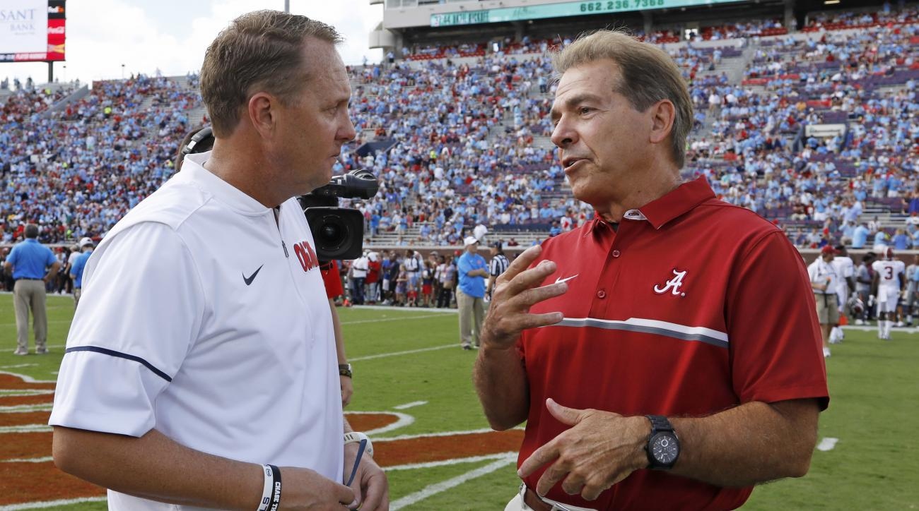 Mississippi head coach Hugh Freeze, left, and Alabama head coach Nick Saban chat before an NCAA college football game, Saturday, Sept. 17, 2016 in Oxford, Miss. (AP Photo/Rogelio V. Solis)