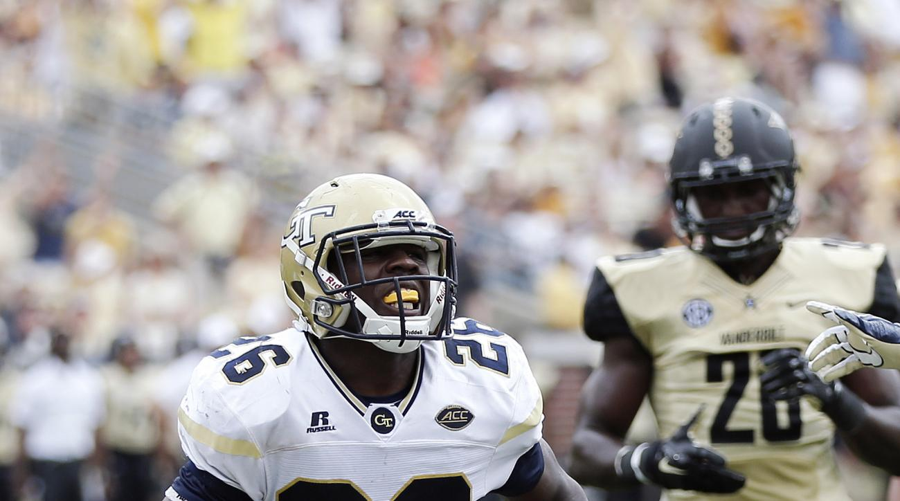 Georgia Tech running back Dedrick Mills (26) celebrates after scoring a touchdown against Vanderbilt in the second half of an NCAA college football game Saturday, Sept. 17, 2016, in Atlanta. (AP Photo/John Bazemore)