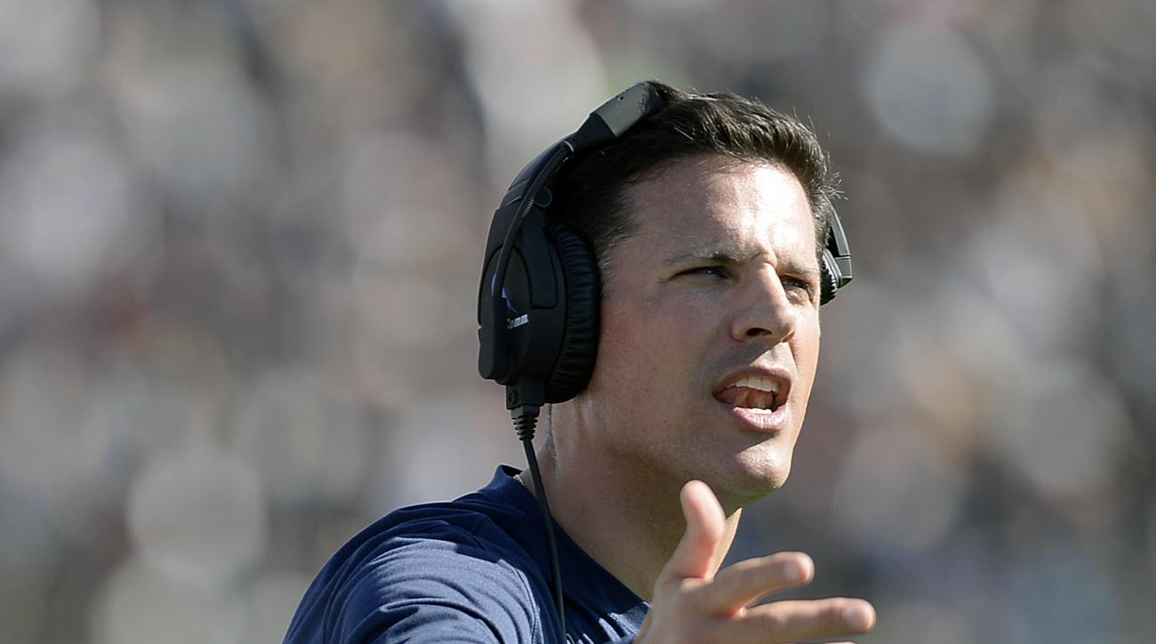 Connecticut head coach Bob Diaco instructs from the sideline in the first half of an NCAA college football game against Virginia  Saturday, Sept. 17, 2016, in East Hartford, Conn. (AP Photo/Jessica Hill)