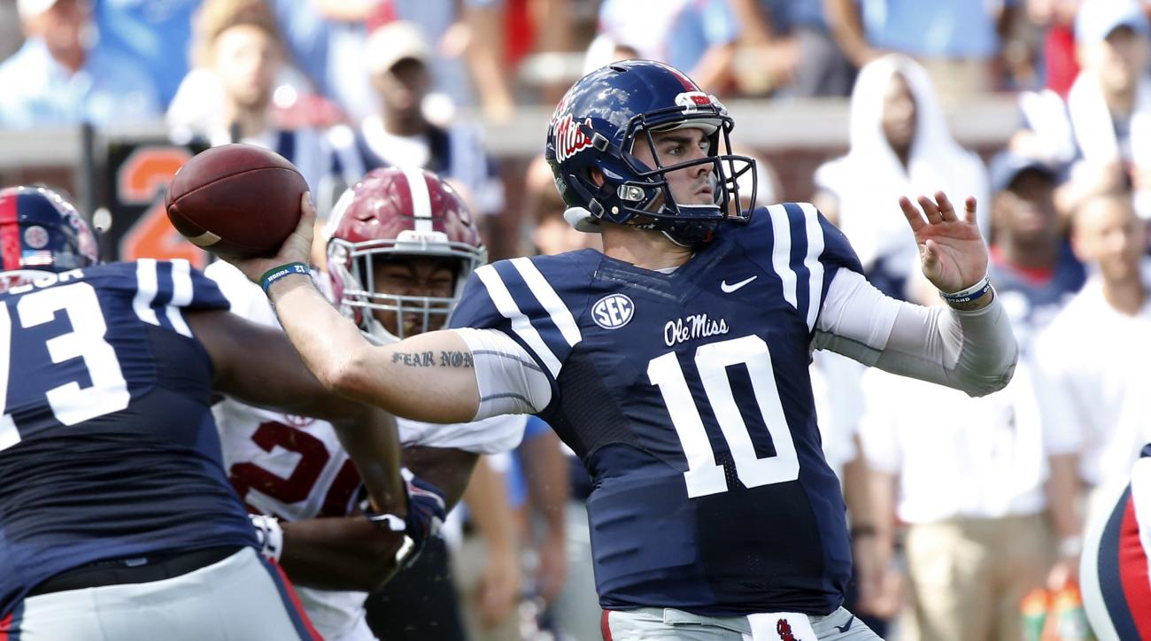 Mississippi quarterback Chad Kelly (10) attempts a pass against Alabama in the first half of an NCAA college football game, Saturday, Sept. 17, 2016 in Oxford, Miss. (AP Photo/Rogelio V. Solis)