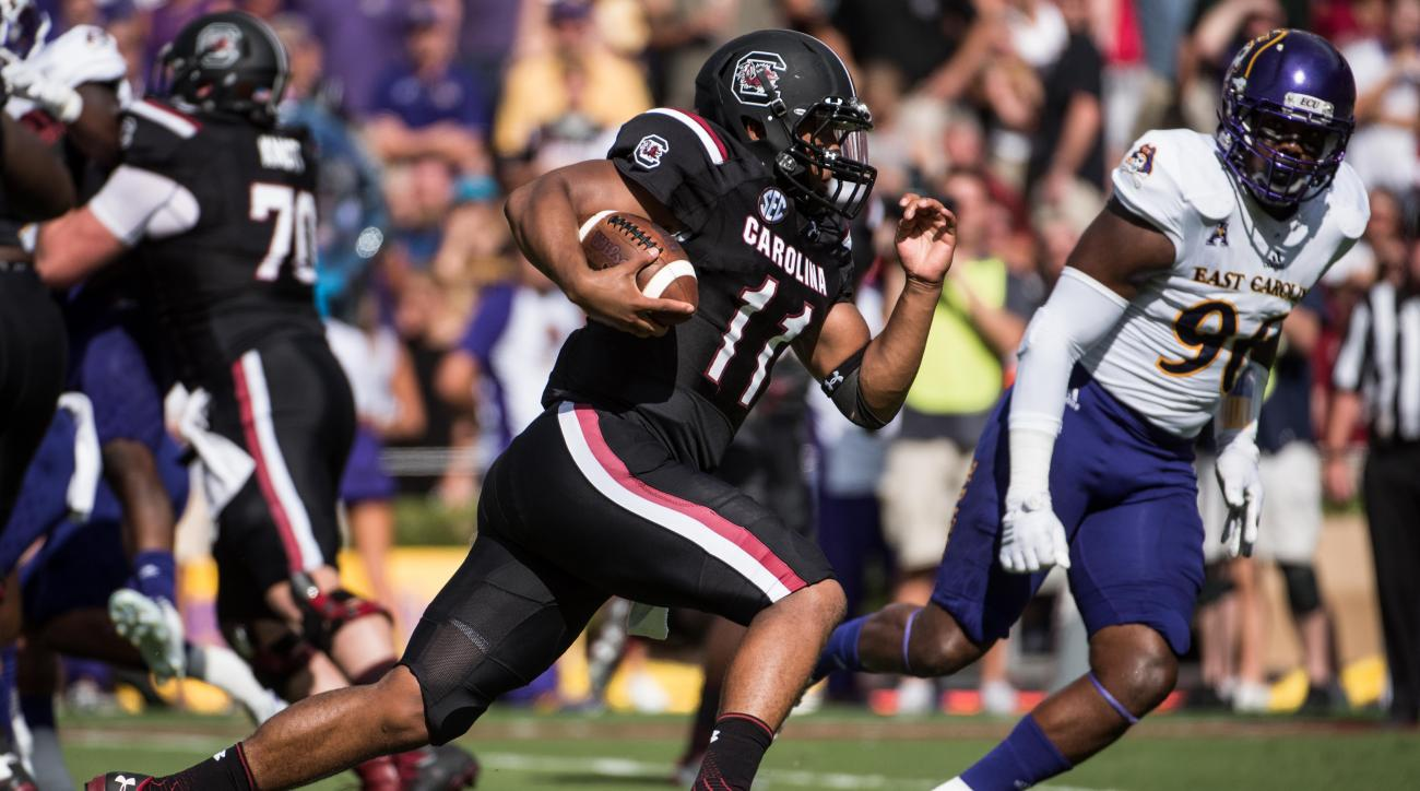 South Carolina quarterback Brandon McIlwain (11) runs for a touchdown against East Carolina during the first half of an NCAA college football game Saturday, Sept. 17, 2016, in Columbia, S.C. (AP Photo/Sean Rayford)