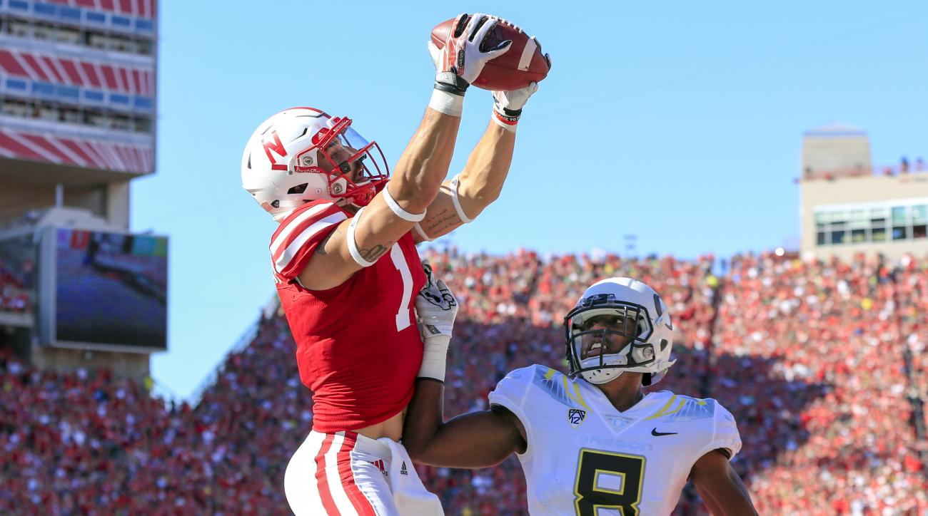 Nebraska wide receiver Jordan Westerkamp (1) catches a touchdown pass over Oregon defensive back Reggie Daniels (8) during the first half of an NCAA college football game in Lincoln, Neb., Saturday, Sept. 17, 2016. (AP Photo/Nati Harnik)