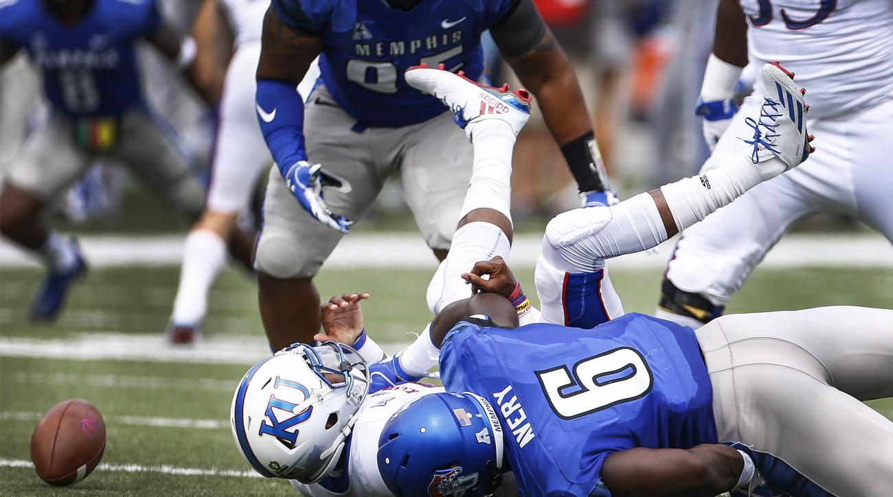 Memphis defender Genard Avery (6) knocks the ball away form  Kansas quarterback Montell Cozart  causing a fumble that the Tigers' recovered during the first quarter  of an NCAA college football game at the Liberty Bowl Memorial Stadium, Saturday, Sept. 17