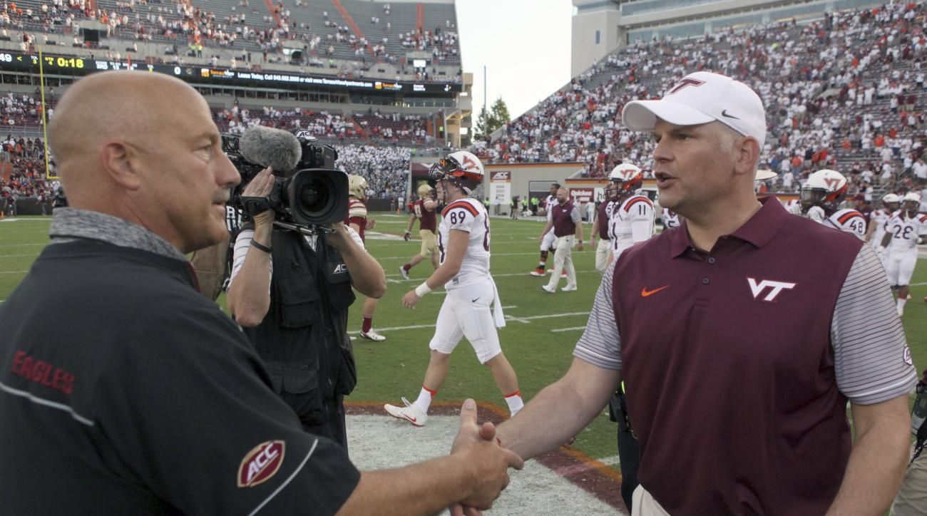 Boston College head coach Steve Addazio, left, and Virginia Tech head coach Justin Fuente, right, shake hands after an NCAA college football game, in Blacksburg Va. Saturday Sept. 17, 2016. Virginia Tech defeated Boston College 49-0. (Matt Gentry/The Roan