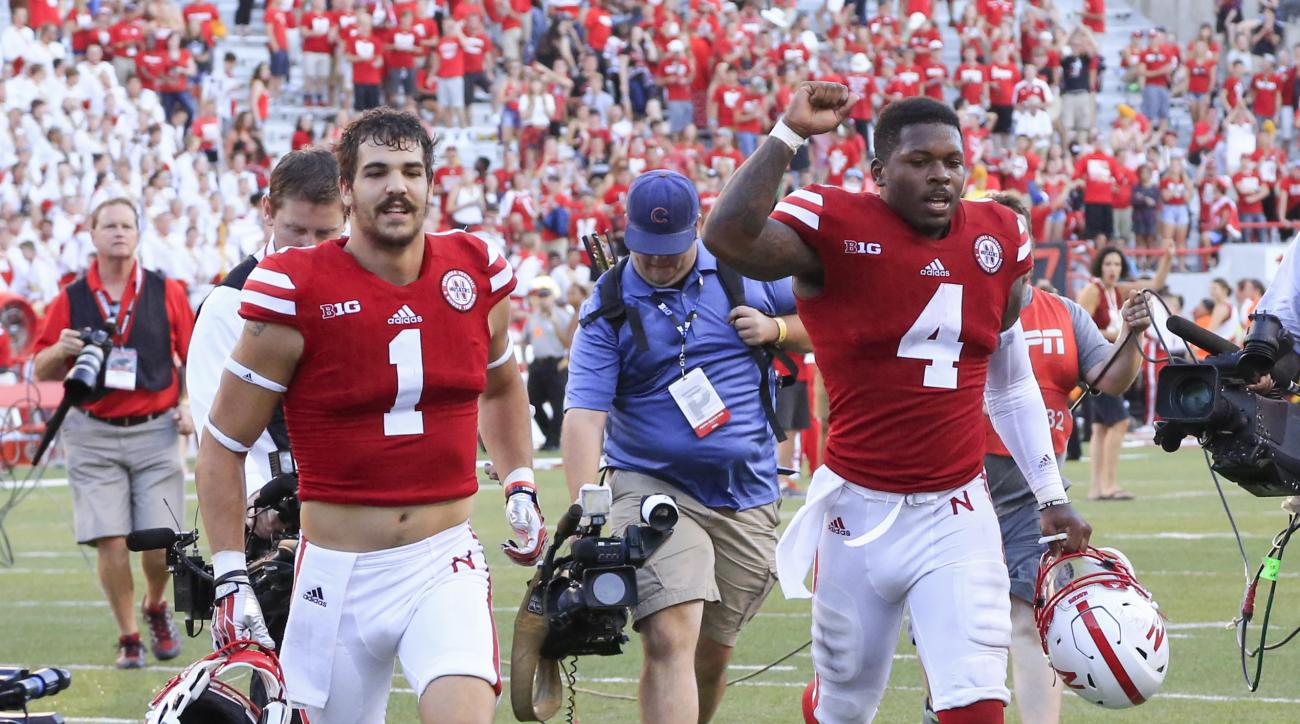 Nebraska quarterback Tommy Armstrong Jr. (4) and wide receiver Jordan Westerkamp (1) run off the field following an NCAA college football game against Oregon in Lincoln, Neb., Saturday, Sept. 17, 2016. Nebraska won 35-32. (AP Photo/Nati Harnik)