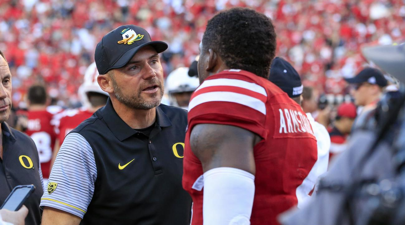 Oregon head coach Mark Helfrich congratulates Nebraska quarterback Tommy Armstrong Jr. (4) following an NCAA college football game in Lincoln, Neb., Saturday, Sept. 17, 2016. Nebraska won 35-32. (AP Photo/Nati Harnik)