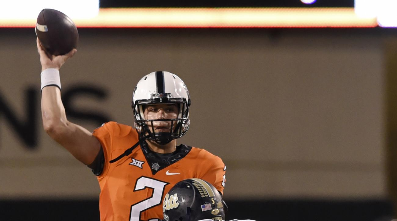 Oklahoma State quarterback Mason Rudolph (2) completes a pass despite pressure from Pittsburgh defensive lineman Ejuan Price (5) during the second half of an NCAA college football game in Stillwater, Okla., Saturday, Sept. 17, 2016. (AP Photo/Brody Schmid