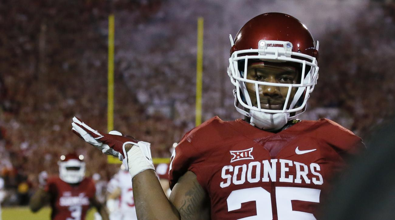 Oklahoma running back Joe Mixon gestures after scoring against Ohio State during the first quarter of an NCAA college football game in Norman, Okla., Saturday, Sept. 17, 2016. (AP Photo/Sue Ogrocki)