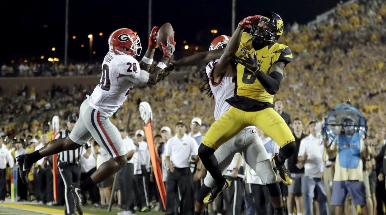 Georgia safety Quincy Mauger, left, intercepts a pass in the end zone intended for Missouri wide receiver J'Mon Moore, right, during the second half of an NCAA college football game Saturday, Sept. 17, 2016, in Columbia, Mo. Georgia won 28-27. (AP Photo/J