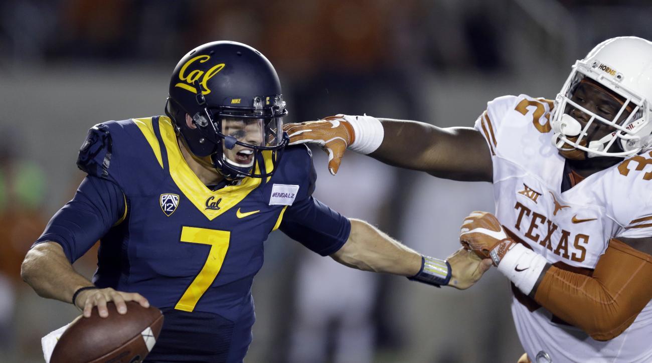 California quarterback Davis Webb (7) is pressured by Texas linebacker Malcolm Roach (32) during the second half of an NCAA college football game Saturday, Sept. 17, 2016, in Berkeley, Calif. California won, 50-43. (AP Photo/Ben Margot)