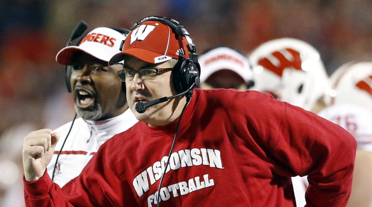 FILE - In this Nov. 7, 2015, file photo, Wisconsin head coach Paul Chryst, foreground, reacts after running back Alec Ingold scored a touchdown in the second half of an NCAA college football game against Maryland. Big Ten teams No. 11 Wisconsin and No. 8