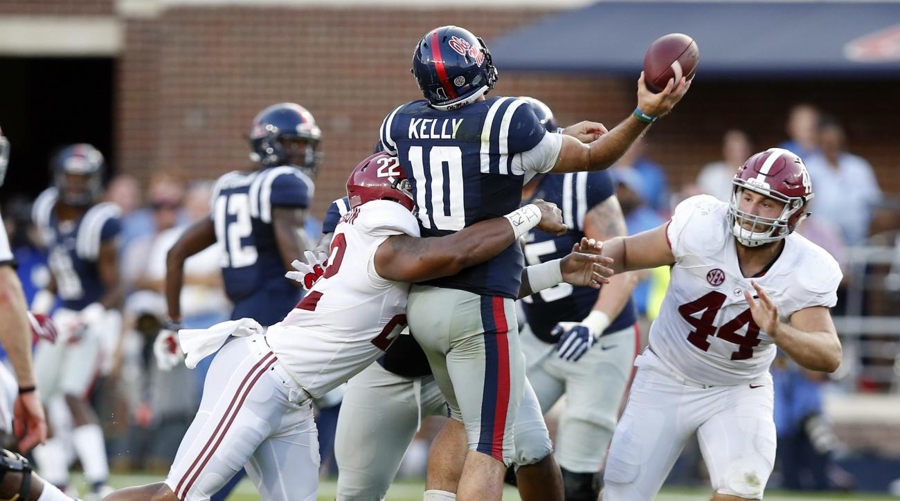 In this Sept. 17, 2016 photograph, Mississippi quarterback Chad Kelly (10) is hit by Alabama linebacker Ryan Anderson (22) and linebacker Dakota Ball (44) as he attempts to pass in the second half of an NCAA college football game, in Oxford, Miss. No. 23