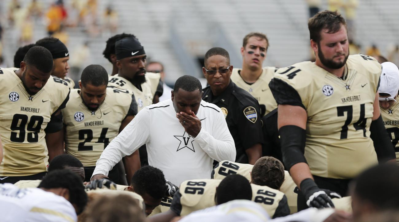 FILE - In this Sept. 17, 2016, file photo, Vanderbilt head coach Derek Mason prays with Vanderbilt and Georgia Tech players after an NCAA college football game, in Atlanta. The defense, Vanderbilt's strength last season, has been battered now over two str