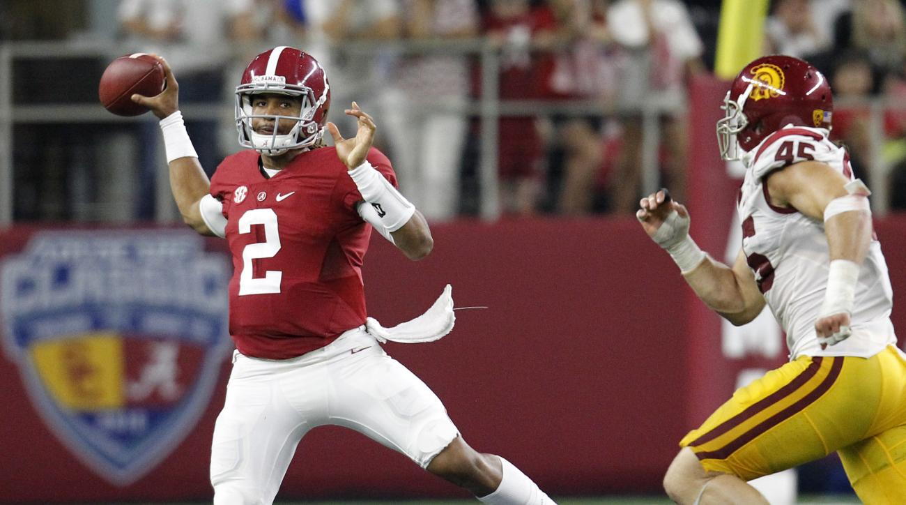 FILE - In this Sept. 3, 2016, file photo, Alabama quarterback Jalen Hurts scrambles out of the pocket to throw a pass under pressure from Southern California defensive end Porter Gustin (45) during an NCAA college football game, in Arlington, Texas. Three