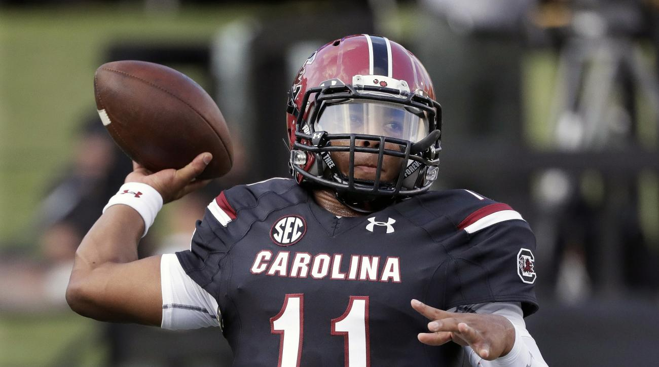 FILE - In this Sept. 1, 2016, file photo, South Carolina quarterback Brandon McIlwain warms up before an NCAA college football game against Vanderbilt, in Nashville, Tenn. Three precocious passers are trying to prove its now possible for true freshmen qua