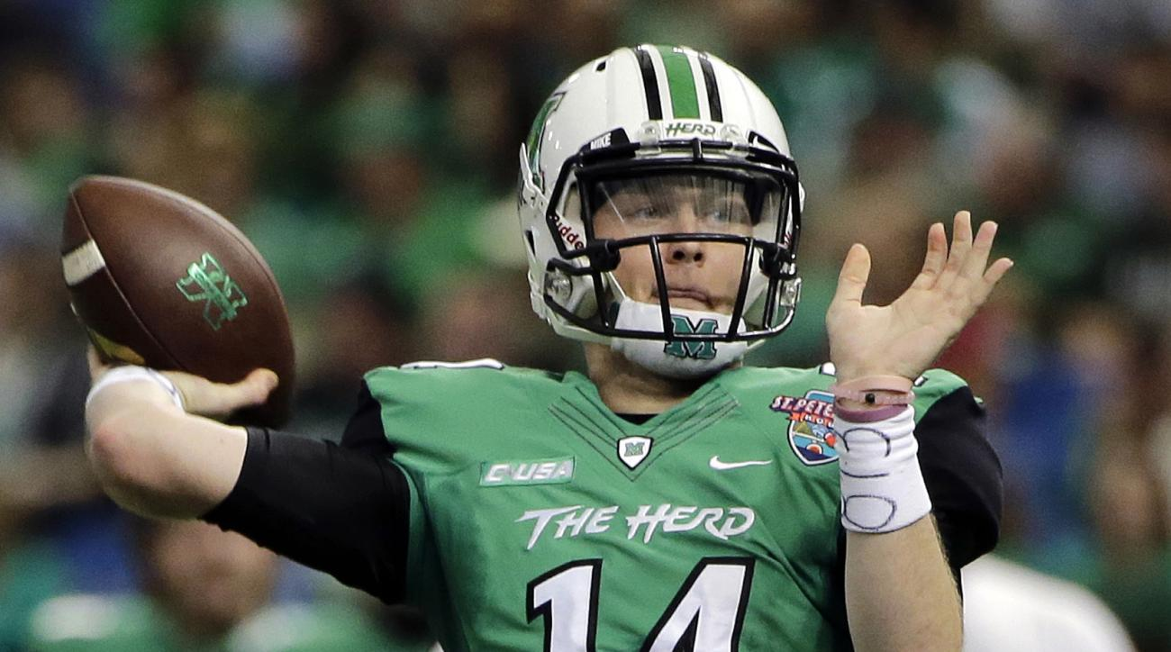 FILE - In this Dec. 26, 2016, file photo, Marshall quarterback Chase Litton throws a touchdown pass to tight during the first quarter of the St. Petersburg Bowl NCAA college football game against Connecticut in St. Petersburg, Fla. Marshall already has se