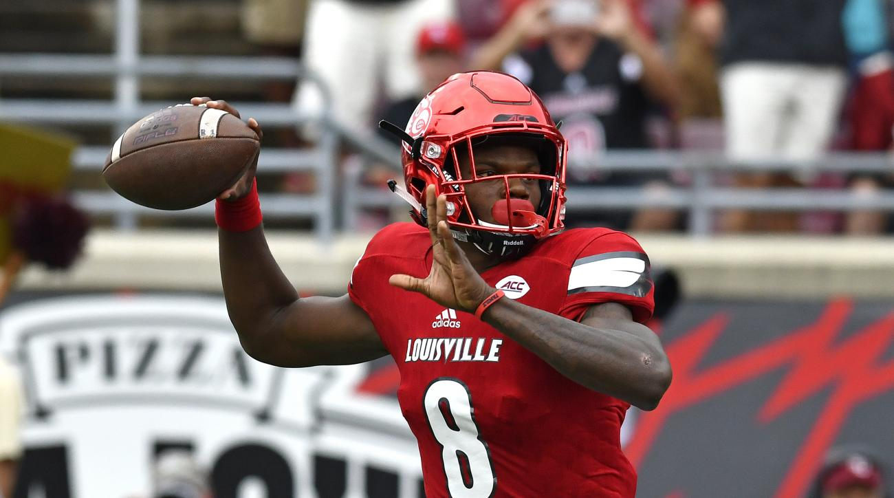 FILE - In this Saturday, Sep. 17, 2016 file photo, Louisville quarterback Lamar Jackson looks for a receiver during the first quarter of an NCAA college football game against Florida State, in Louisville Ky. Jackson and the third-ranked Cardinals travel t