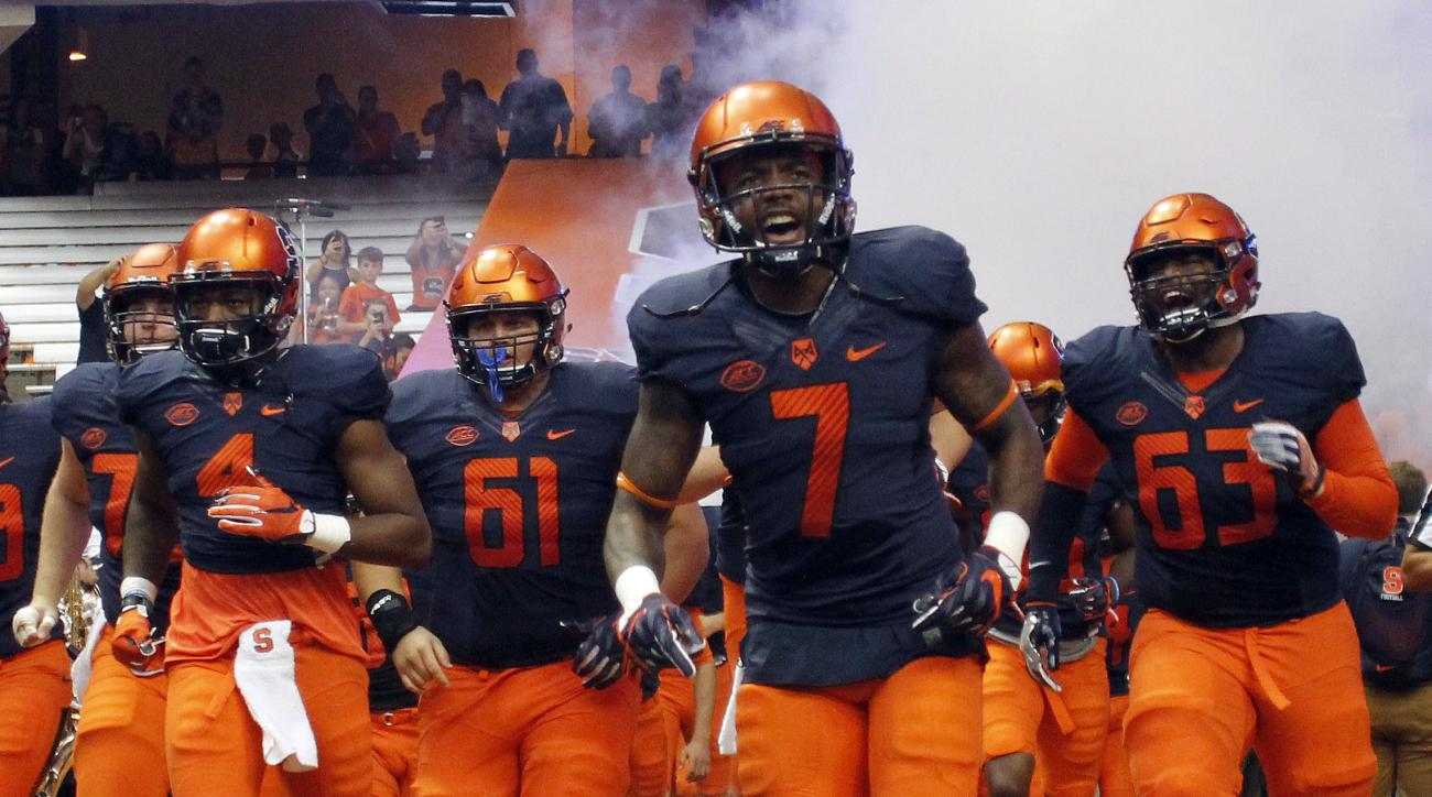 FILE - In this Sept. 17, 2016 file photo, Syracuse's Amba Etta-Tawo, center, runs on the field with teammates before an NCAA college football game against South Florida in Syracuse, N.Y. Babers is the first to admit that it wasnt exactly love at first sig