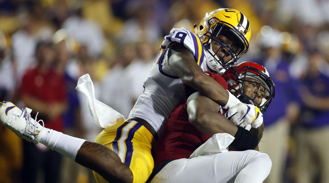 FILE - In this Sept. 10, 2016, file photo, Jacksonville State quarterback Eli Jenkins is sacked by LSU defensive end Arden Key (49) in the second half of an NCAA college football game in Baton Rouge, La. With five sacks through three games, Key is about o
