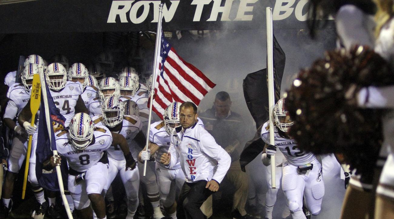 FILE - In this Nov. 11, 2015, file photo ,Western Michigan coach P.J. Fleck leads his team onto the field before an NCAA college football game against Bowling Green at Waldo Stadium in Kalamazoo, Mich.  The 35-year-old Fleck still talks with the same kind