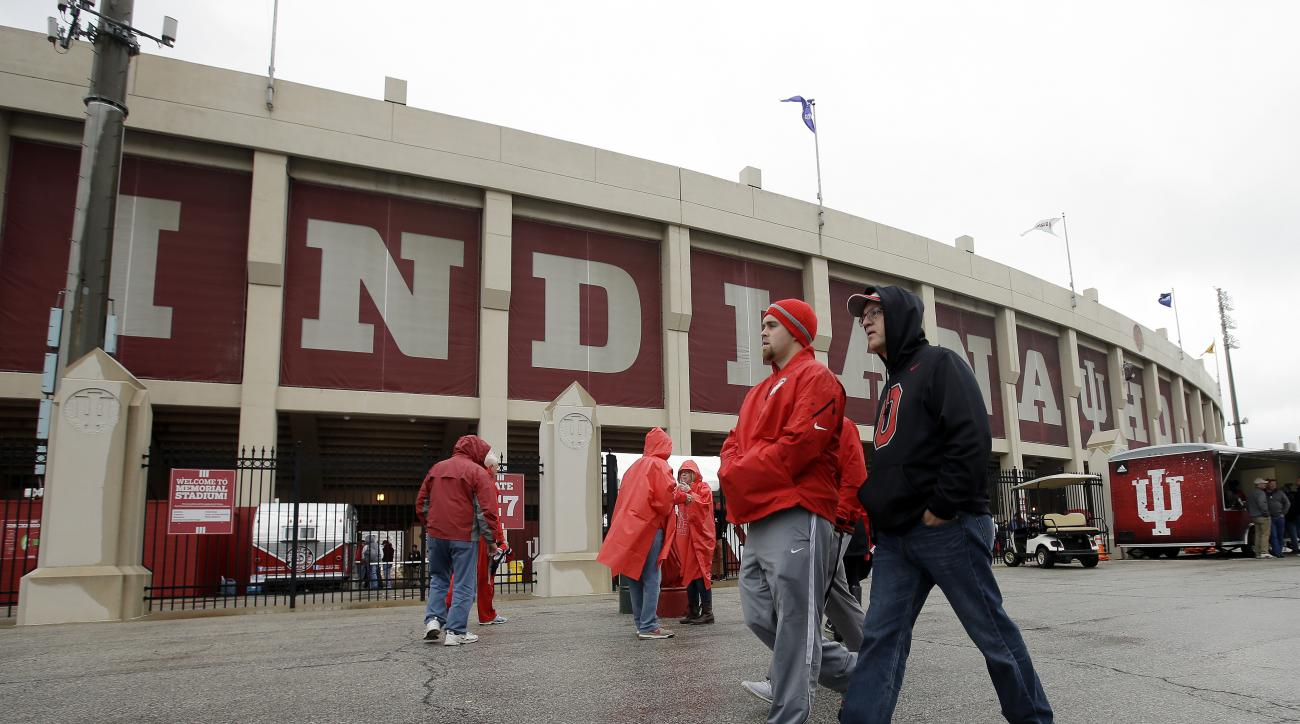 Ohio State fans walk outside of Memorial Stadium before an NCAA college football game against Indiana, Saturday, Oct. 3, 2015 in Bloomington, Ind. (AP Photo/Darron Cummings)