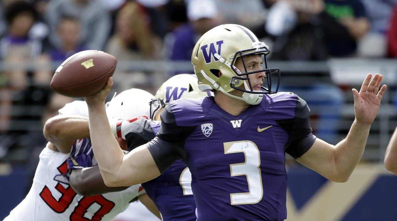 FILE - In this Sept. 3, 2016, file photo, Washington quarterback Jake Browning throws against Rutgers in the second half of an NCAA college football game,in Seattle. The Huskies' sophomore leads the nation in passing efficiency at 206.9 and has thrown for