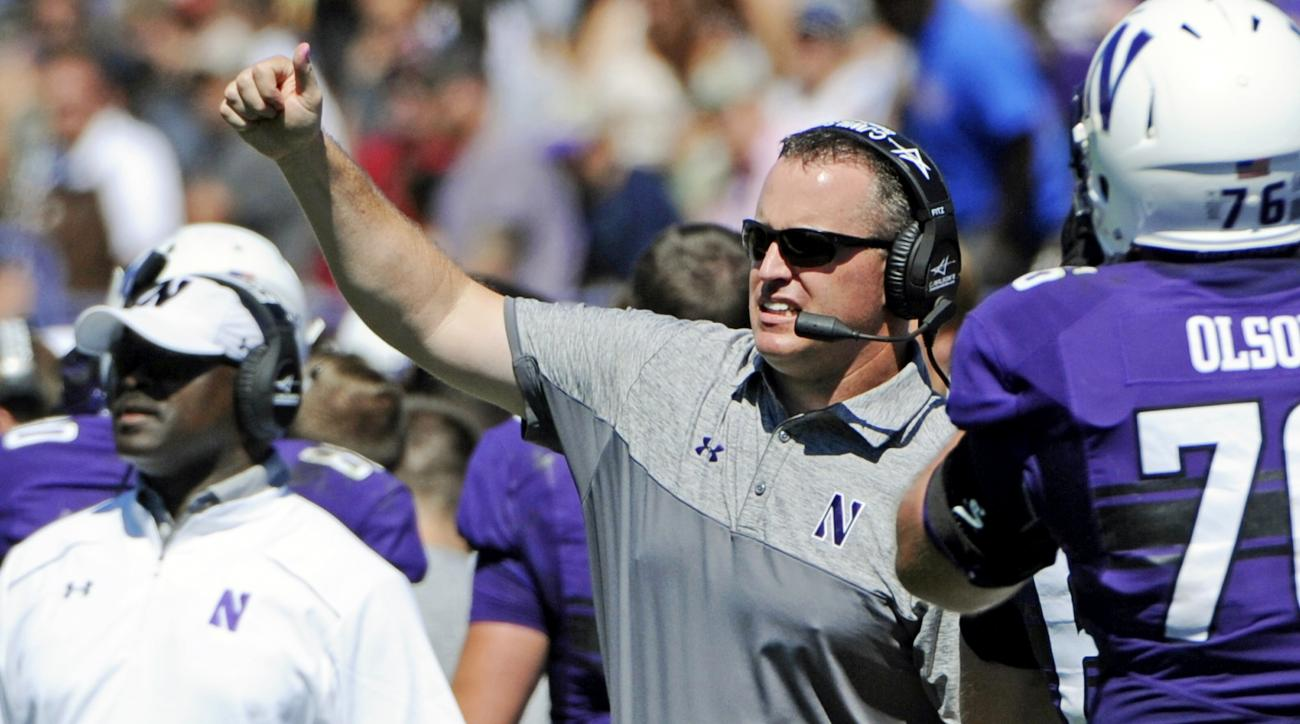 FILE - In this Sept. 3, 2016, file photo, Northwestern head coach Pat Fitzgerald directs his team during a 22-21 loss to Western Michigan in an NCAA college football game in Evanston, Ill. Northwestern, who had two opening losses before beating Duke last